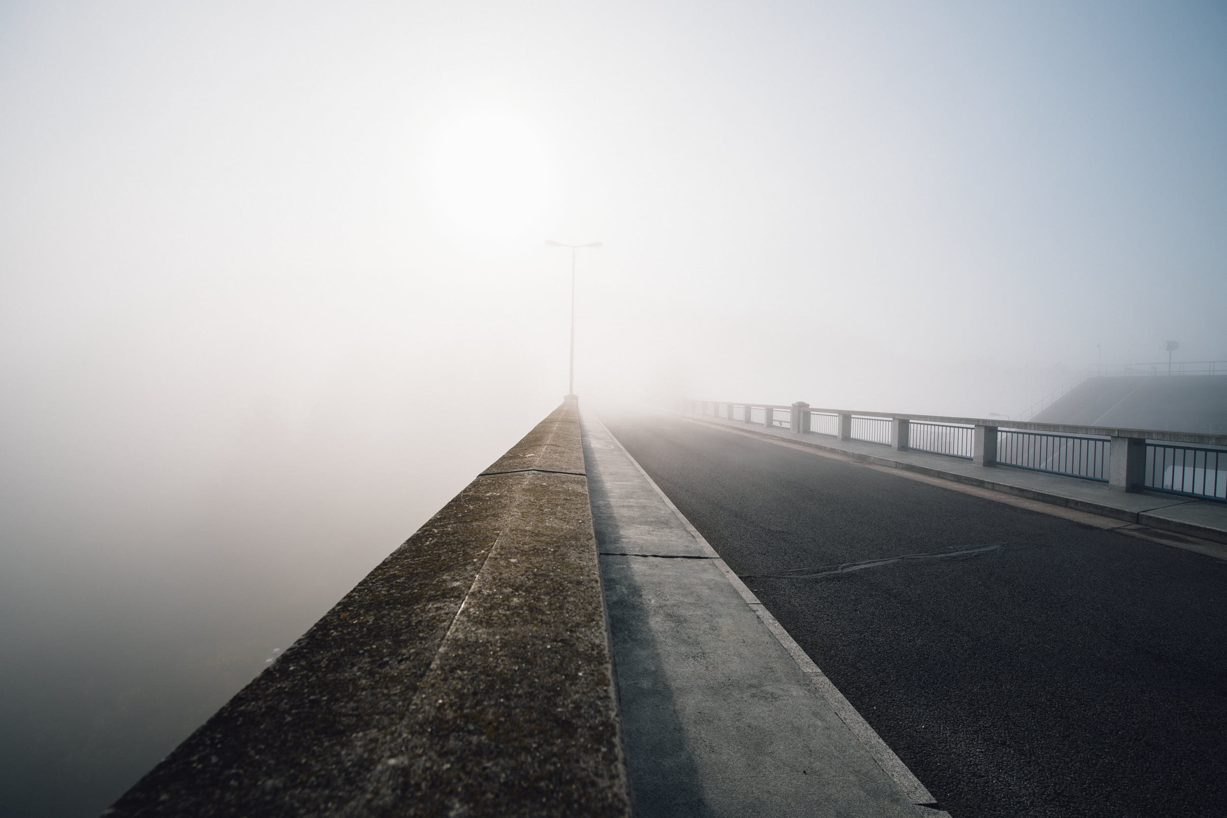 Minimal landscape photography: foggy morning on a bridge.