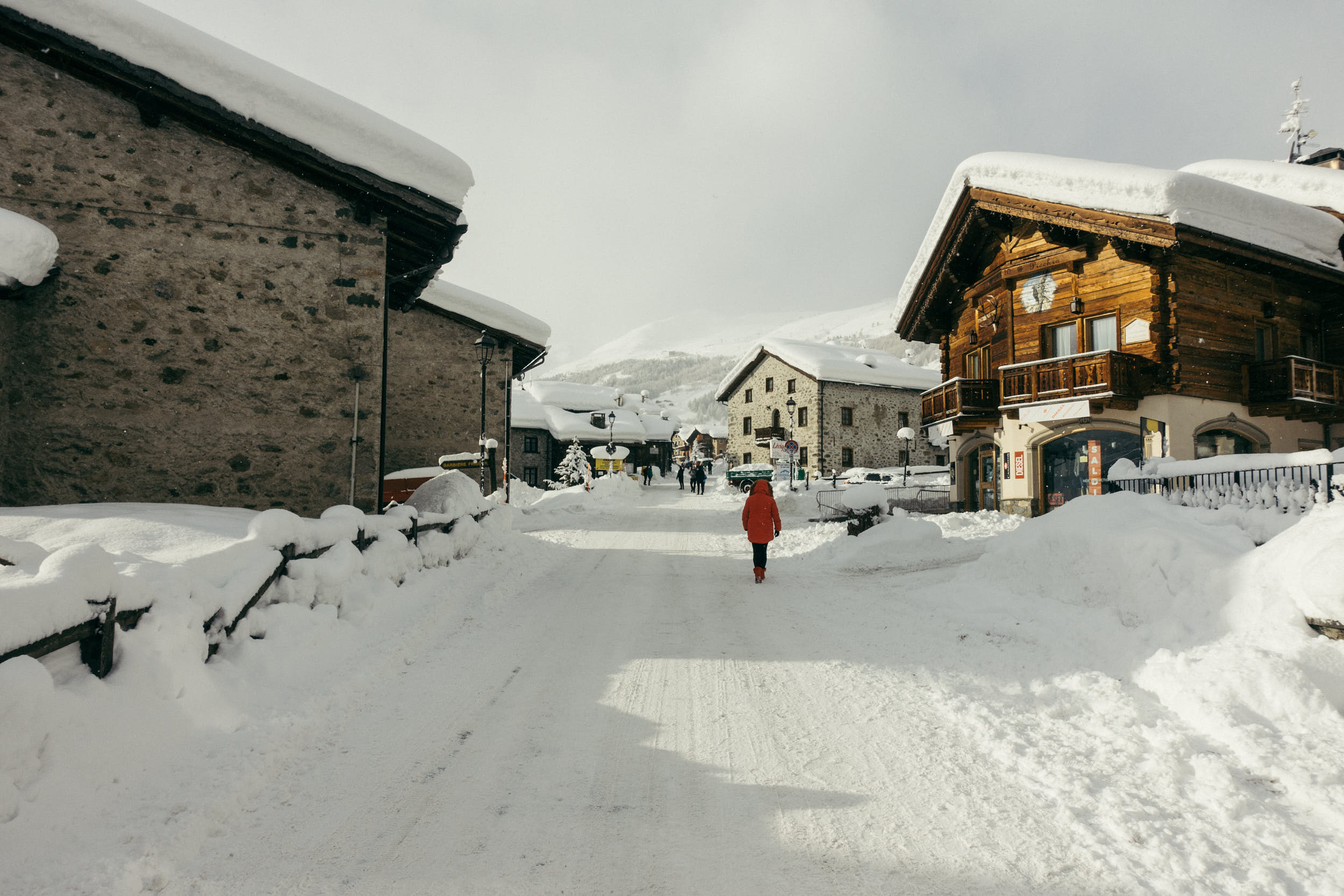 Beautiful travel photography of a mountain village covered in snow.