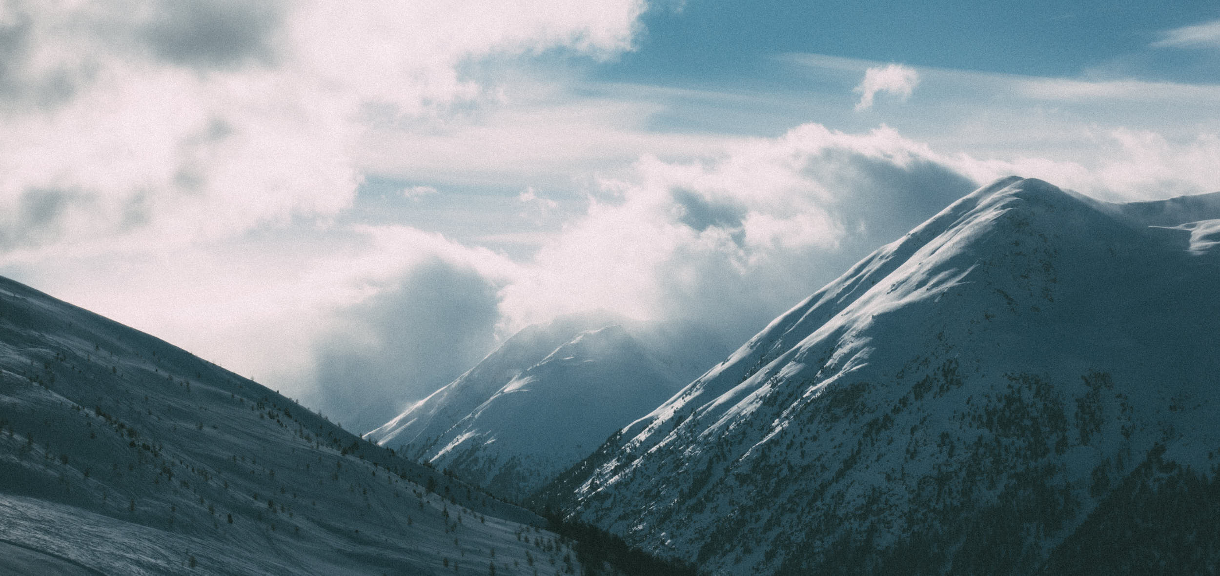 Beautiful landscape travel photography of a mountain with a lot of snow.