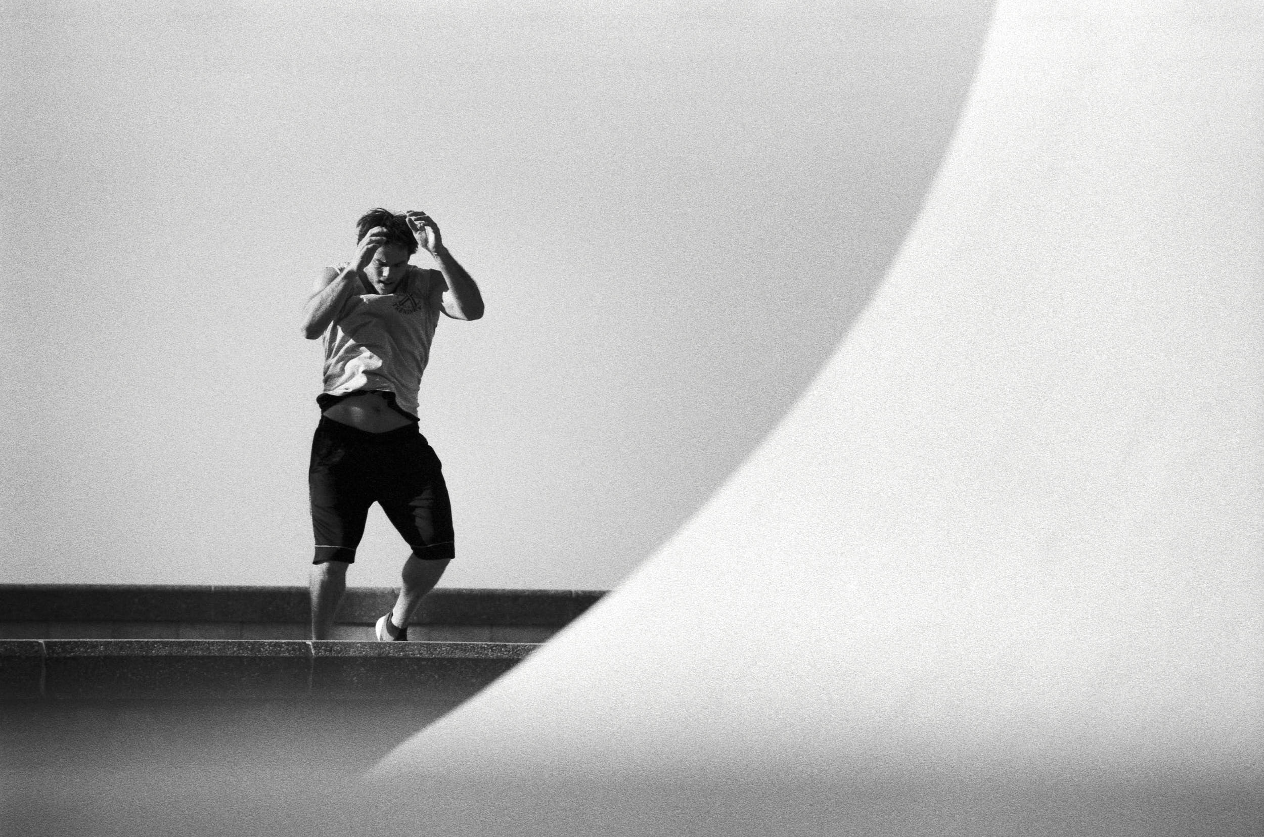Fitness athlete working out in a black and white geometrical composition.