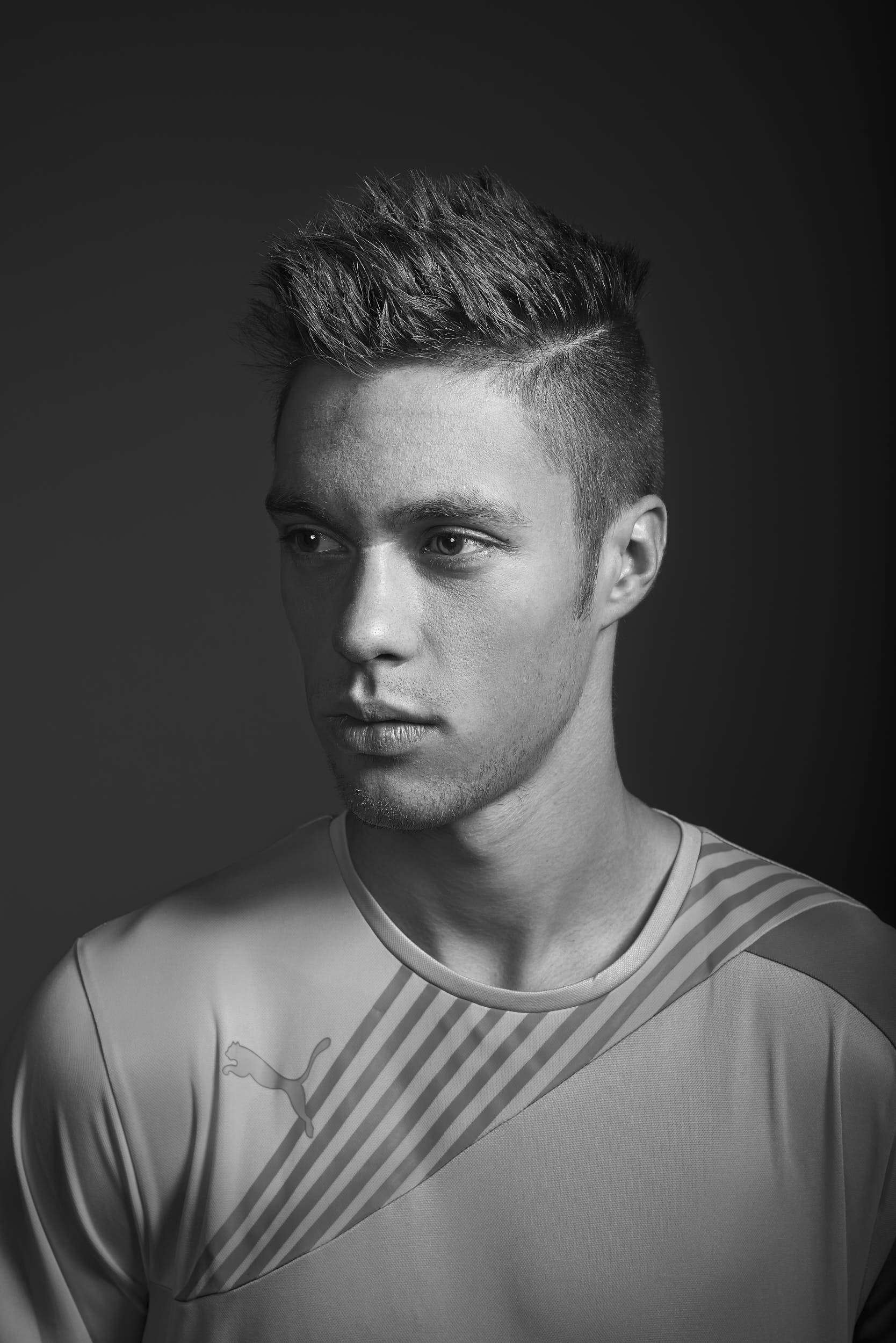 Black and white portrait of a football player.
