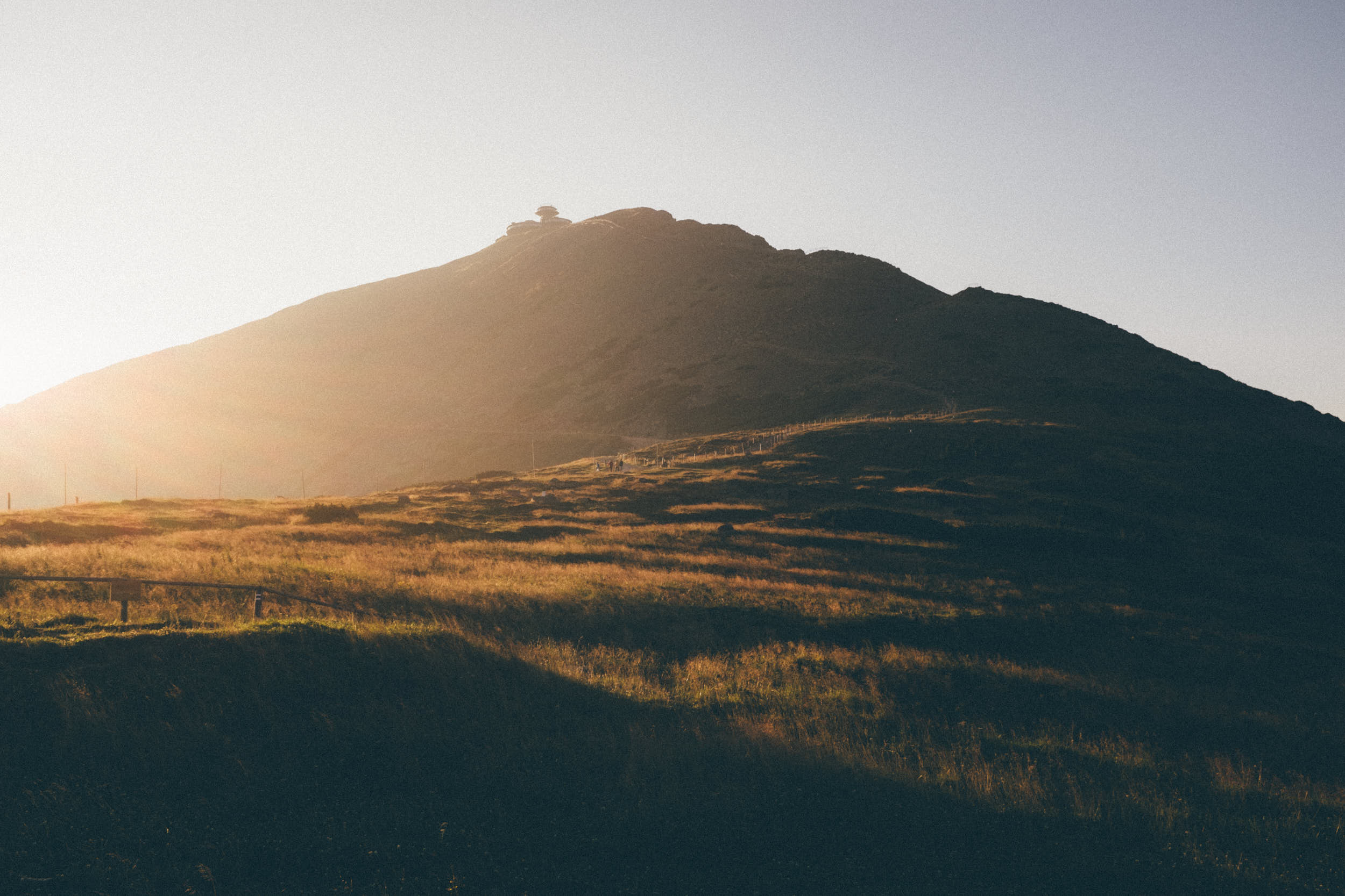 Cinematic landscape photography: mountain ridge in beautiful warm morning light.