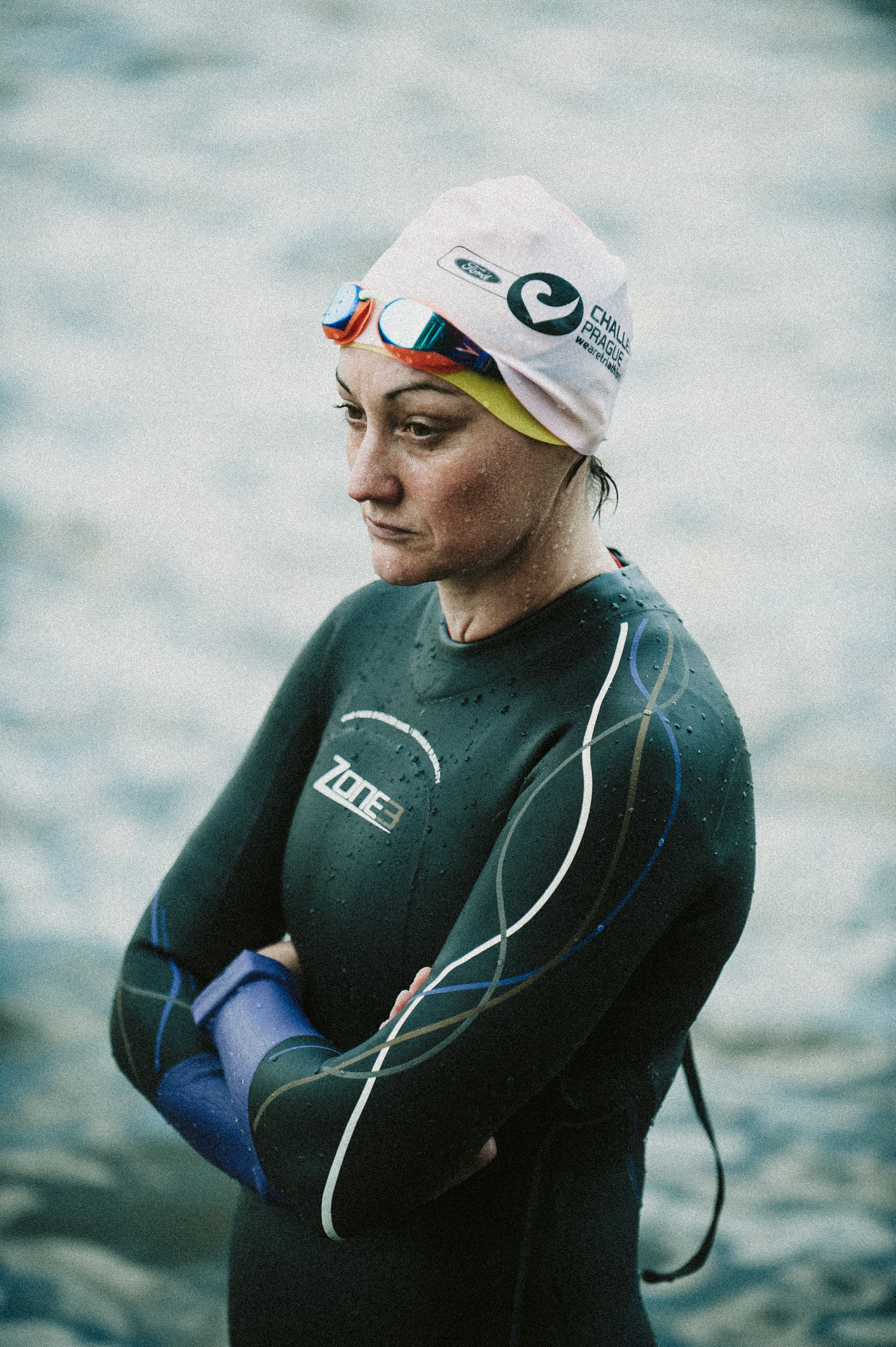 Moody portrait of a triathlete in wetsuit getting ready for the race.