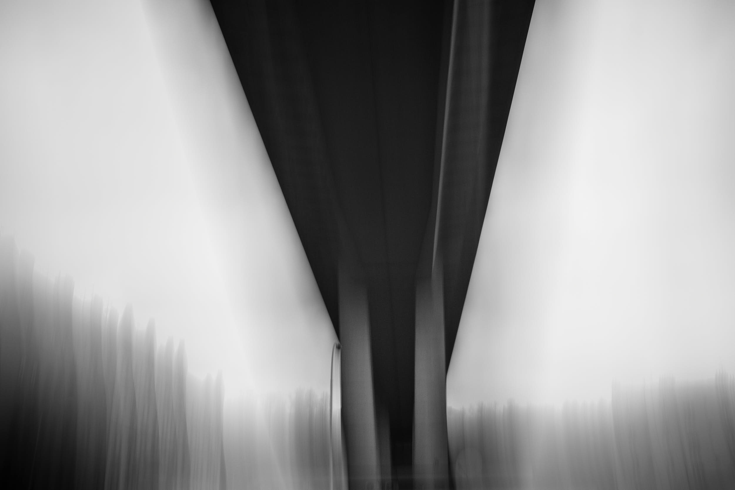 Abstract black and white photography of a bridge with motion blur.