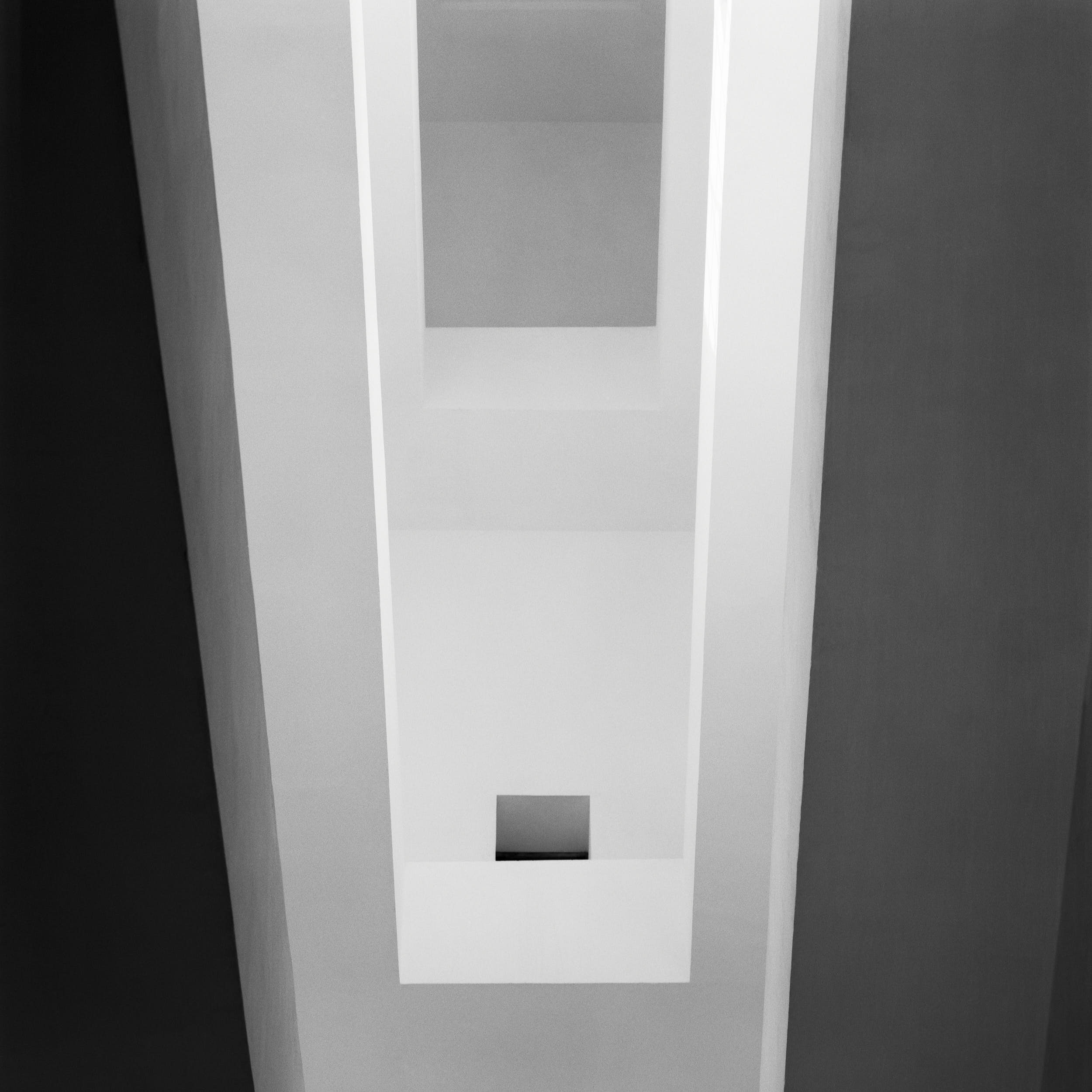 Geometric minimal fine art photography of a staircase in a modernist church.