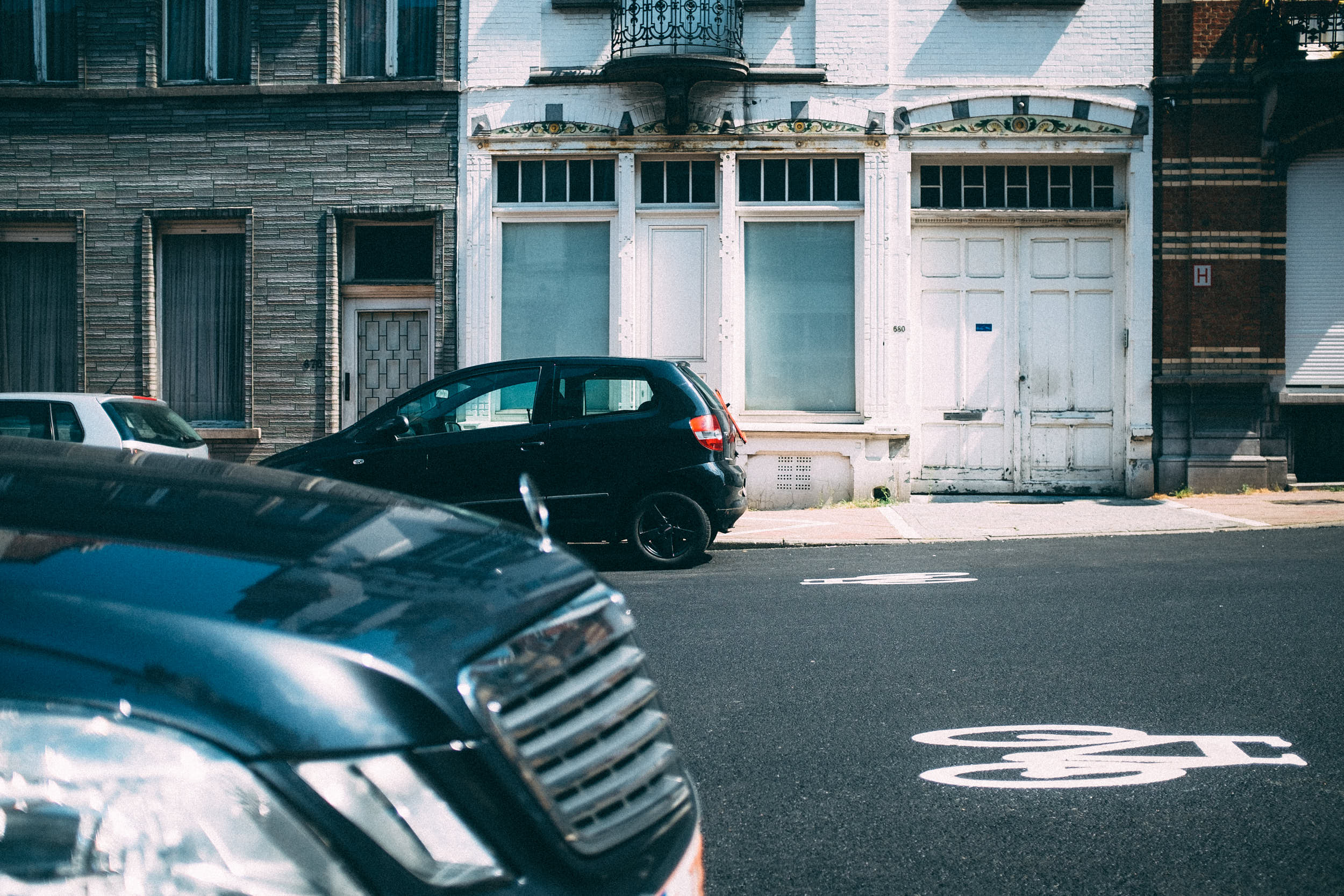 Travel photography: cars parked on the street of Brussels, Belgium.