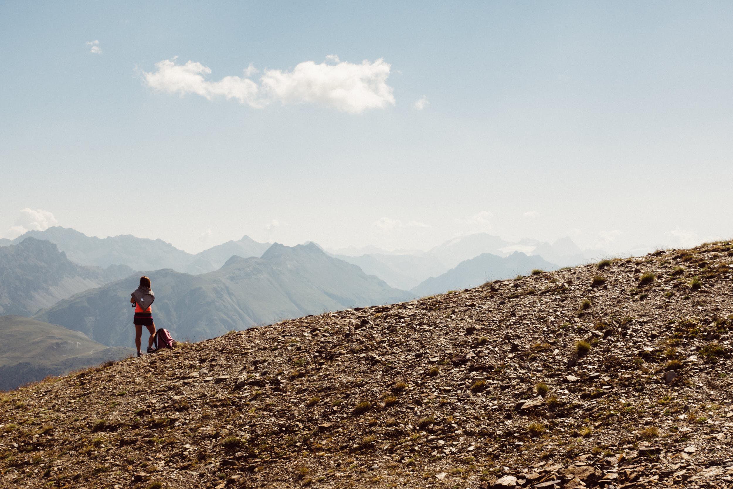 Travel photography: woman enjoying beautiful mountain view in Italian Alps.
