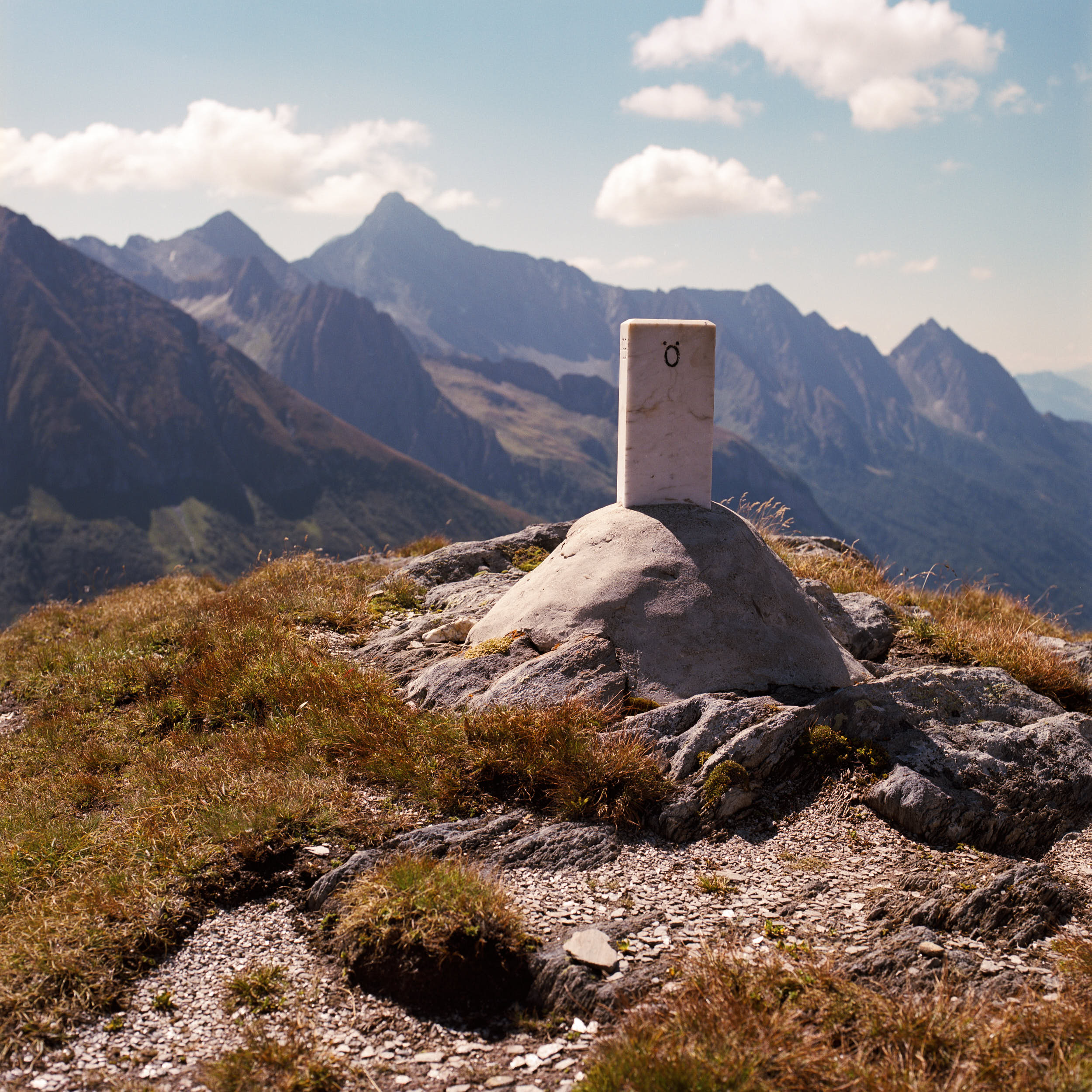A marble stone which marks the border between Austria and Italy on a mountain pass.