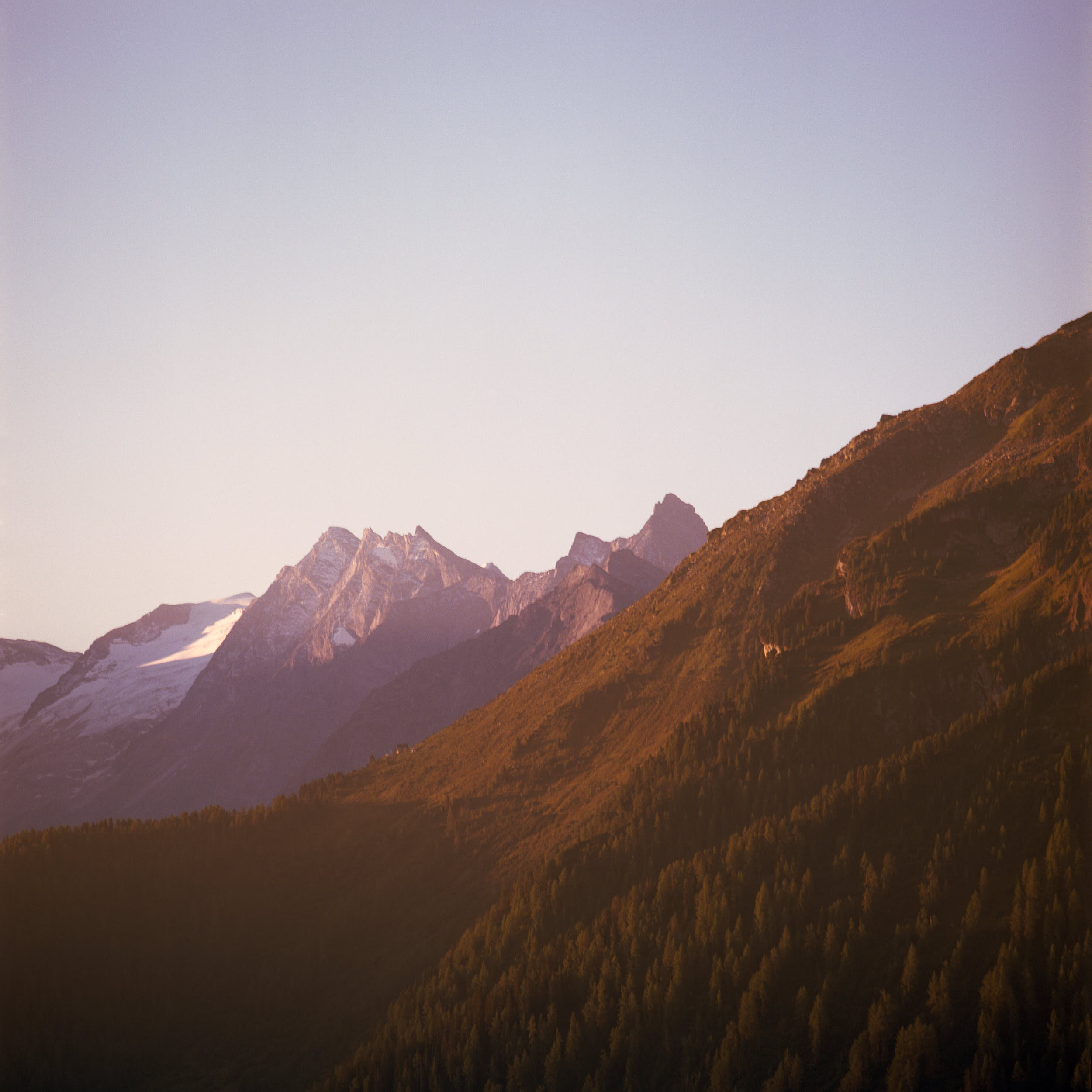 First sunlight hitting the top of alpine peaks. Shot on medium format color film.