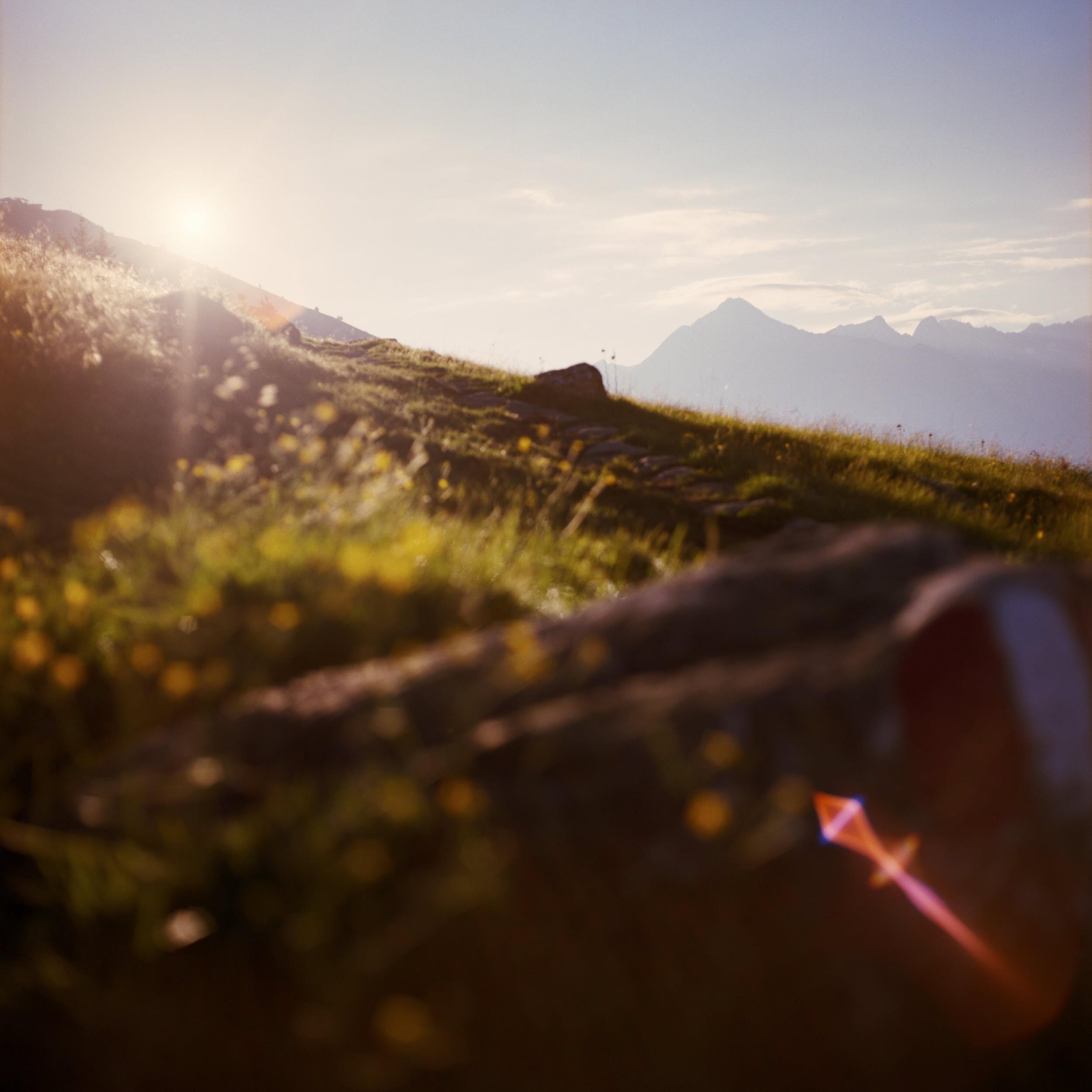 First sunlight hitting the top of alpine peaks. Shot on medium format color film.