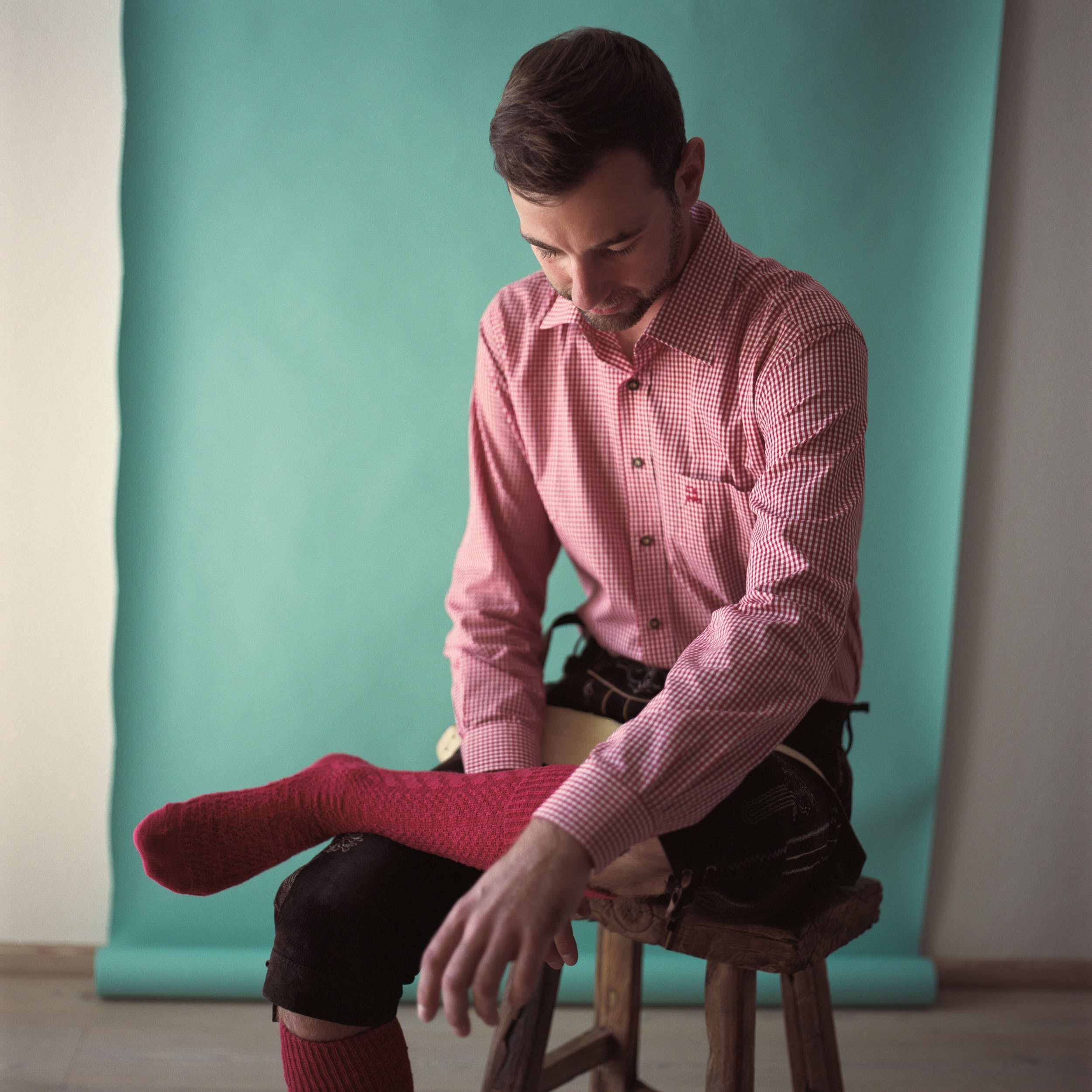 Medium format portrait of an austrian man in a traditional wardrobe.